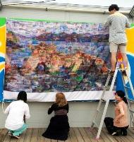 子どもたちの海の絵をモザイク画にした大漁旗=岩手県大船渡市の「おおふなと夢商店街」(朝日新聞デジタルより)